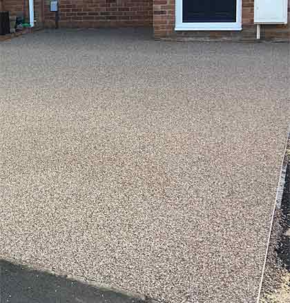 Residential driveway using resin bonded